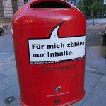 a red litter bin in the city center of Hamburg in Germany Fur mich zaehlen nur Inhalte