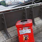 a red litter bin on a bridge in Hamburg Germany