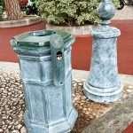 a green litter bin in the streets of Monaco city