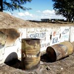 barrils of TOTAL used as trash bins in Beira Mozambique