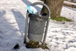 a street litter bin after the snow storm Darcy in Heeze the Netherlands