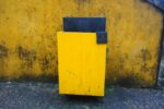 a yellow litter bin by the Pena palace in Sintra, Portugal