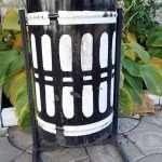a black and white litter bin in a street of Chisinau in Moldova