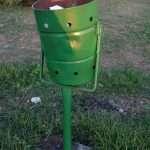 A green litter bin in Durres, Albania