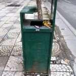 an old litter bin in a street of Tirana Albania
