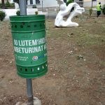a green litter bin close to the albanian orthodox cathedral of Tirana, Albania