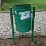 a green litter bin behind the theater of Tirana in Albania