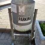 a bin in a parking lot in the capital of Albania, Tirana