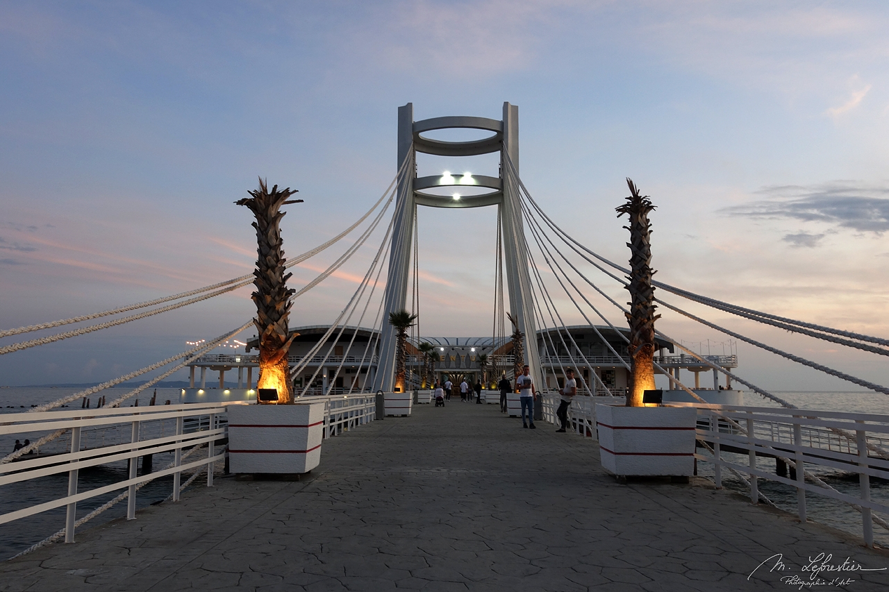 Albania: watch the sunset from the bridge on Ventus Harbor in Durres