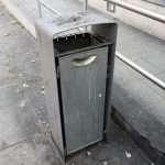 a grey litter bin in a street of Prishtina in Kosovo