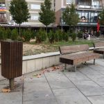 a brown litter bin matching the benches in Pristina capital of Kosovo