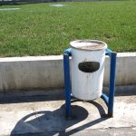 a blue and white litter bin in a gas station not very far from Gorem in Albania
