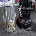 a bin with a transparant plastic bag by the train station Montparnasse in Paris France