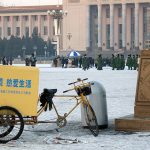 a litter bin in the middle of Tiananmen square in Beijing during winter time