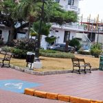two litter bins by benches on a square in the city center of Panama city in Panama