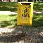 a yellow litter bin by the Technical University (TU) of Eindhoven, Netherlands