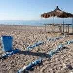 a blue litter bin on the Drymades beach in Dhermi Albania